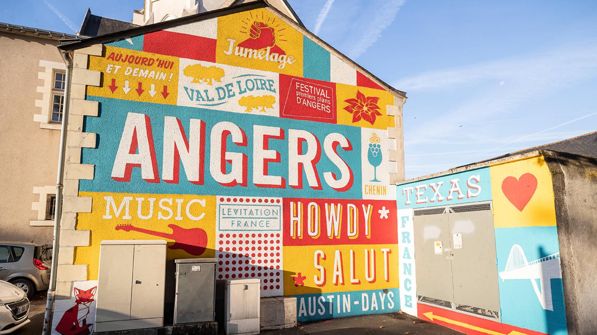 Peinture street art sur la façade d'un immeuble